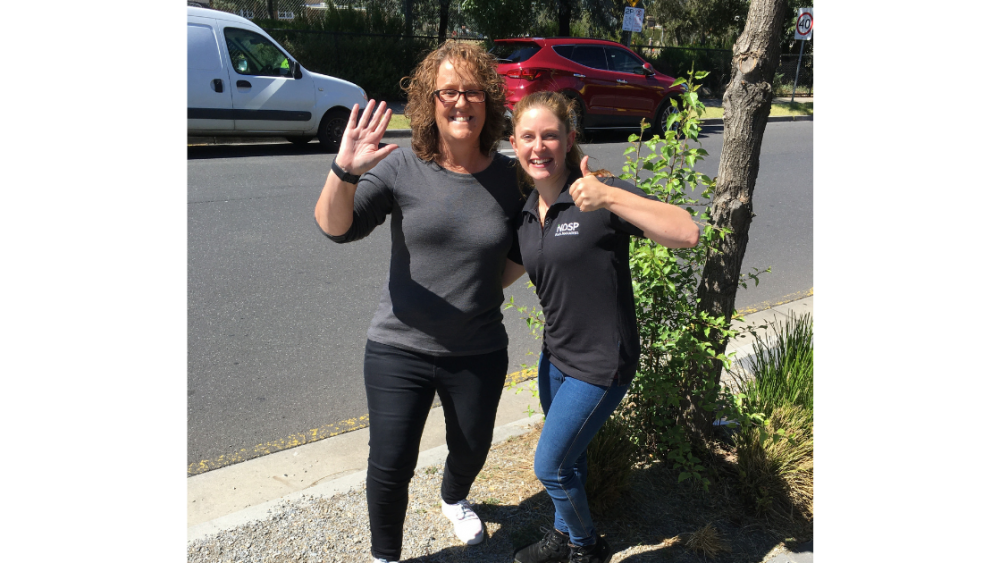 Emilie and Jane waving at the camera